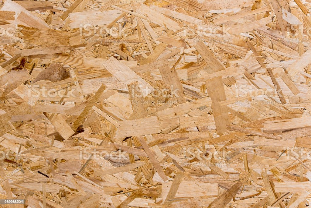 Pressed wooden board background or texture stock photo