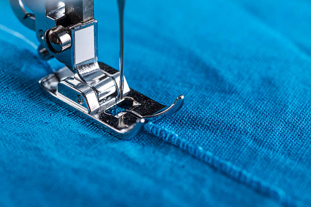 presser foot and textile - sewing machine needle stock photos and pictures