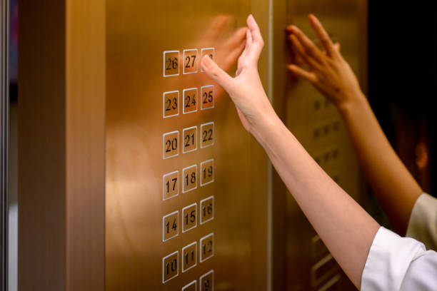 Presses elevator buttons stock photo