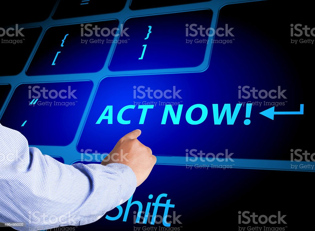 Pressing act now key stock photo