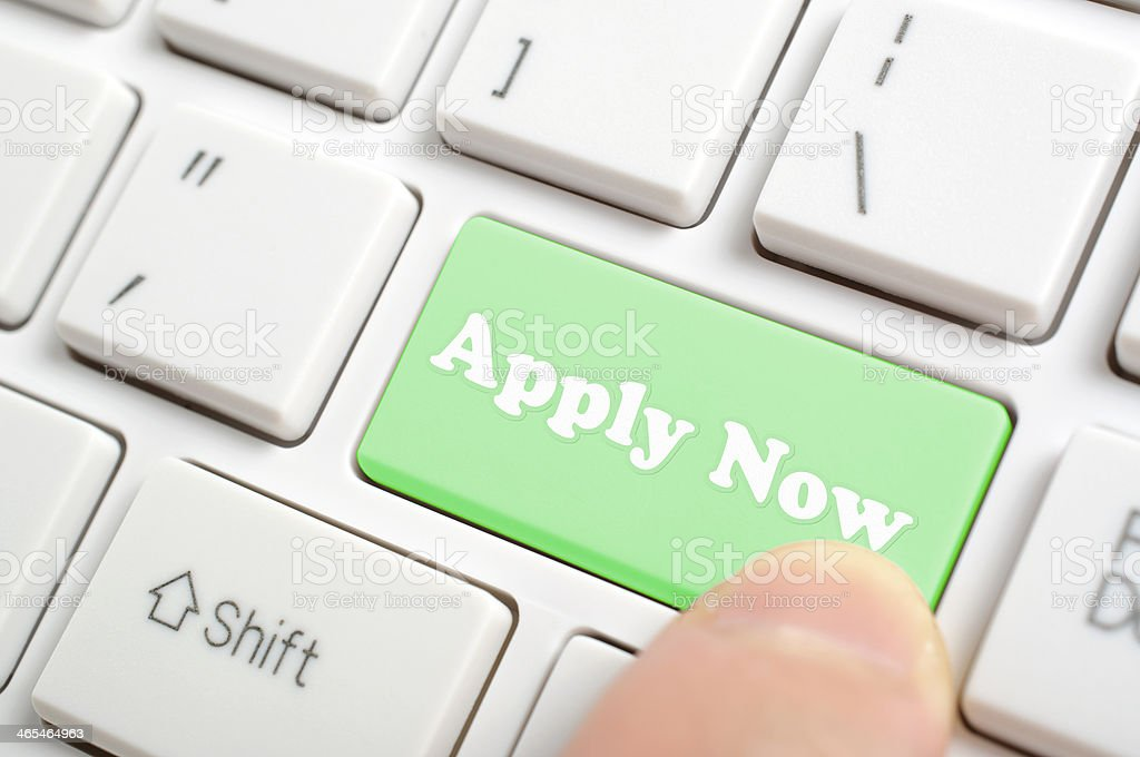 Pressing apply now on keyboard stock photo