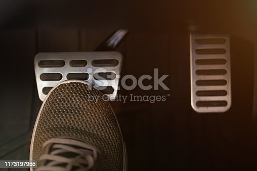 Pressing break car pedal  with shoe close up view