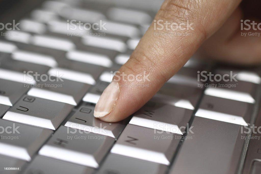 Pressing computer key royalty-free stock photo