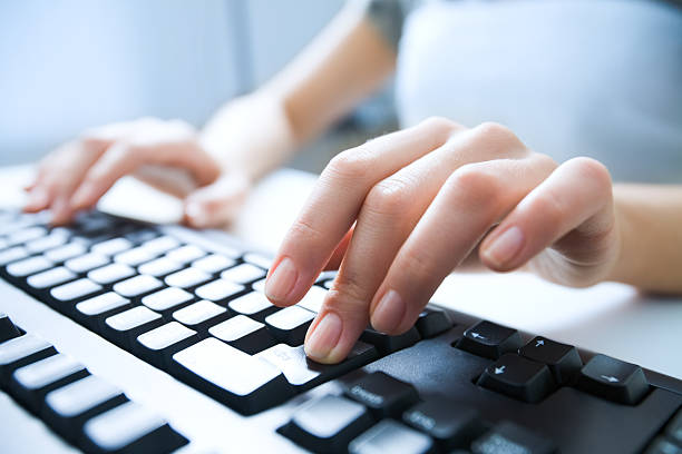 Pressing enter button Close-up of female hand pressing enter key to start the system computer keyboard stock pictures, royalty-free photos & images