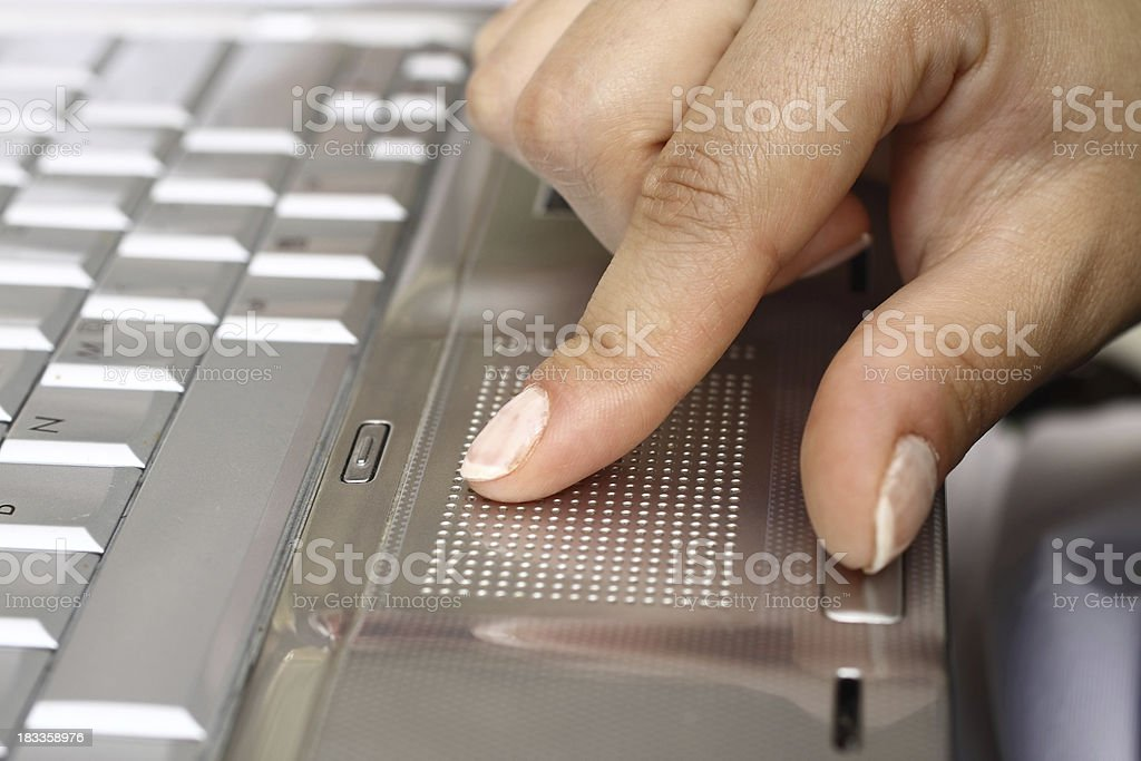 Pressing laptop touchpad royalty-free stock photo