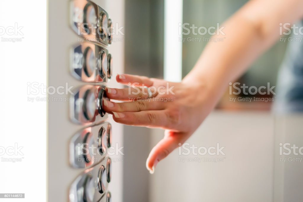 Pressing lift button stock photo