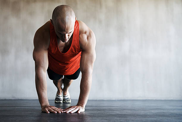 pressing on and increasing his stamina - push up stock photos and pictures