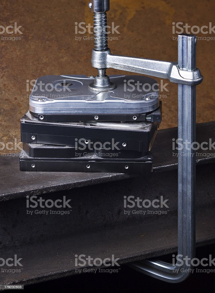 pressing stack of hard disk drives with clamp royalty-free stock photo