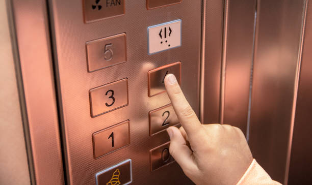 pressing the fourth floor button in the elevator stock photo stock photo