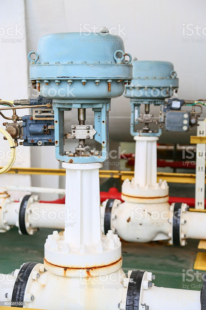 Pressure control valve in oil and gas process and controlled stock photo
