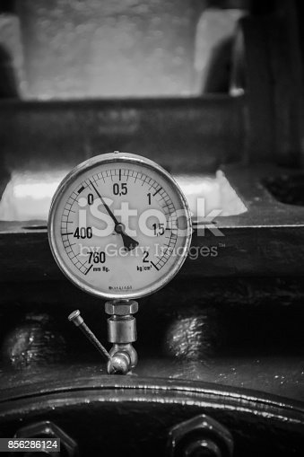 istock Pressure gage manometer, pipe and valves on the background. 856286124