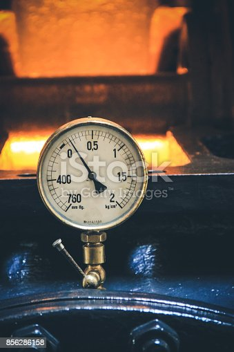 istock Pressure gage manometer, pipe and valves on the background. 856286158