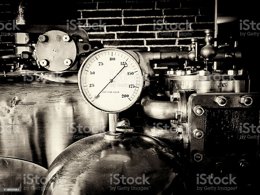 Pressure gauge and cylinders, black and white stock photo