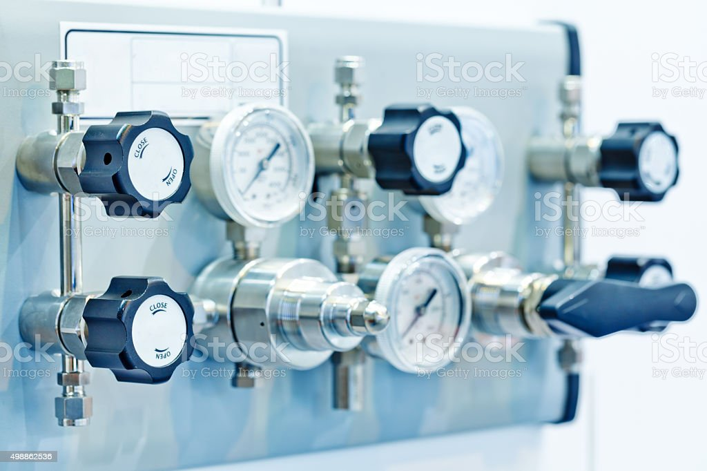 Pressure gauge and valve stock photo