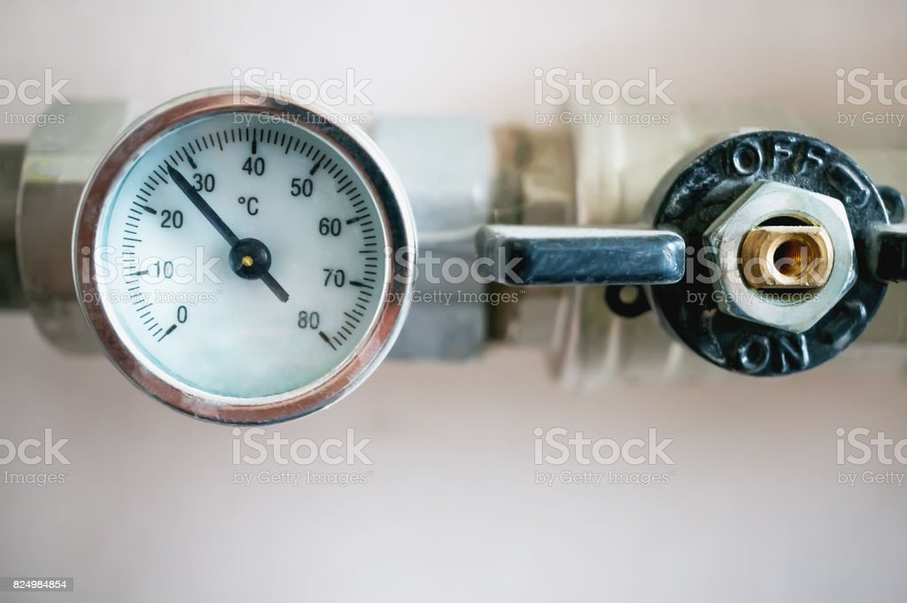 Pressure gauge for regulating the temperature of the water in the heating system stock photo