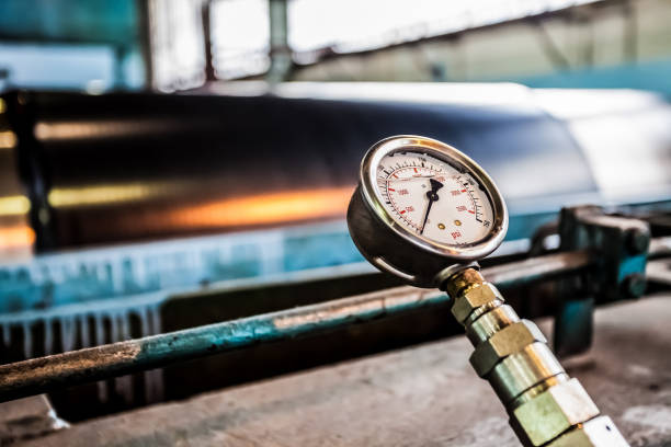 Pressure gauge in a factory stock photo