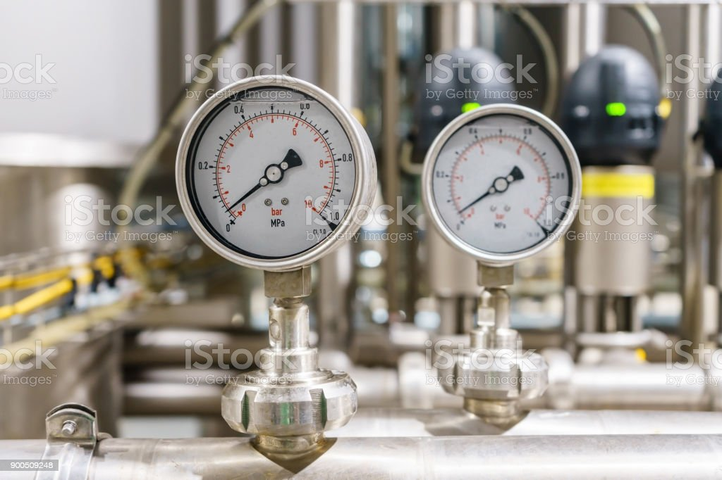 Pressure gauge, measuring instrument close up on pneumatic control system. stock photo