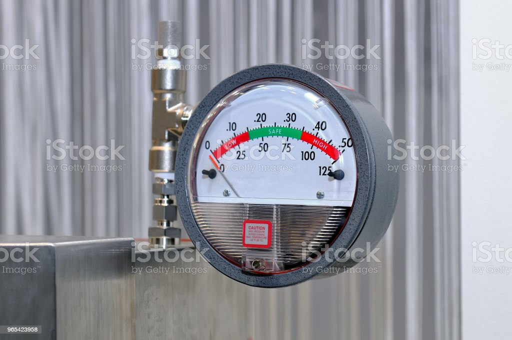 Pressure gauge on a blurry industrial background. royalty-free stock photo