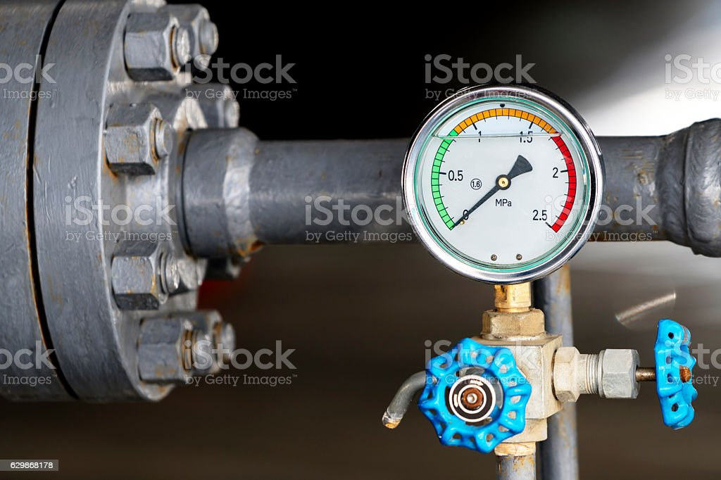 Pressure gauge on oil pump stock photo
