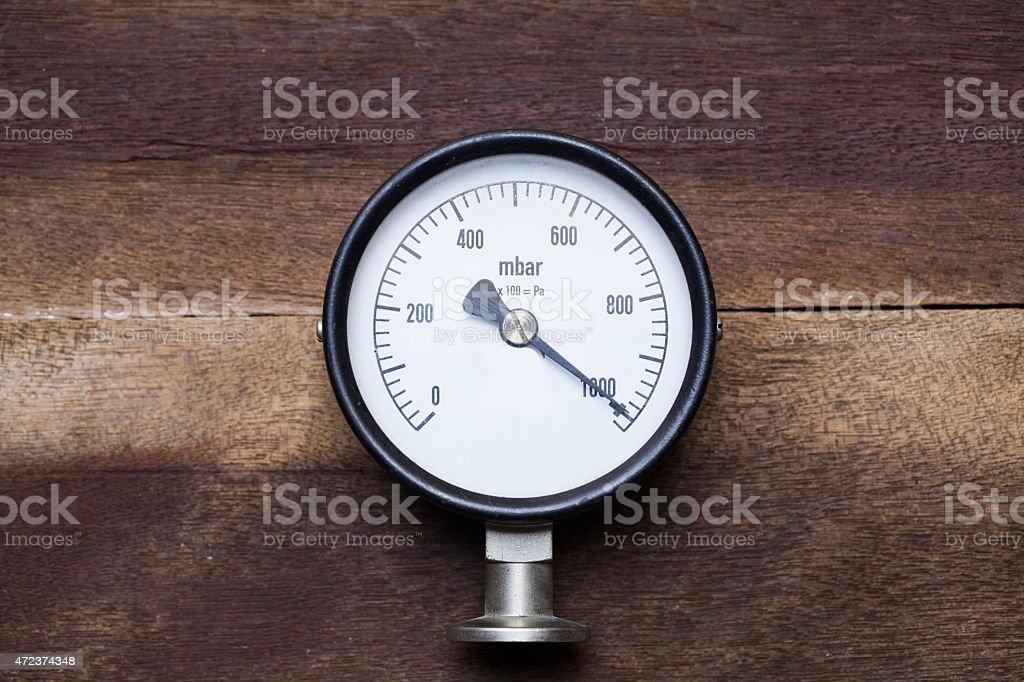 pressure gauge on wood background stock photo