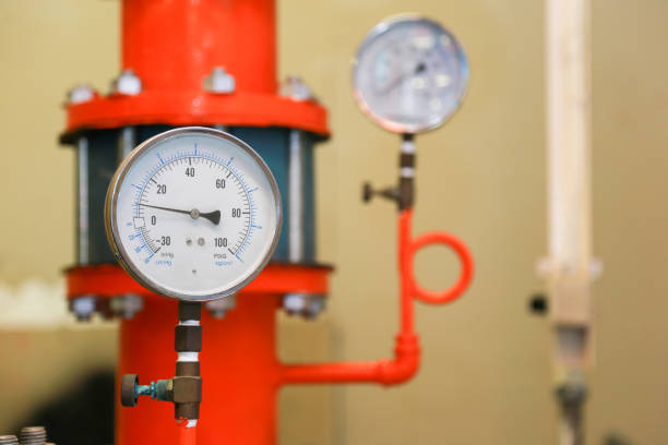 pressure gauge psi meter in pipe and valves of fire emergency system industry. stock photo