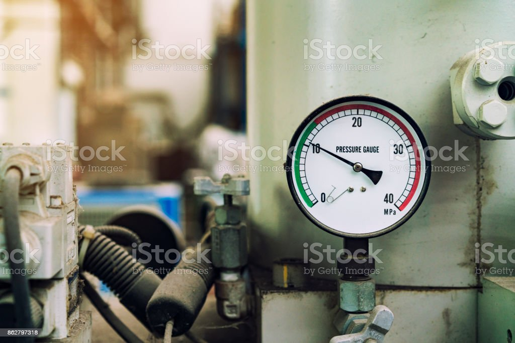 pressure gauge was mounted on the old machine, measuremant and equipment in the industry stock photo