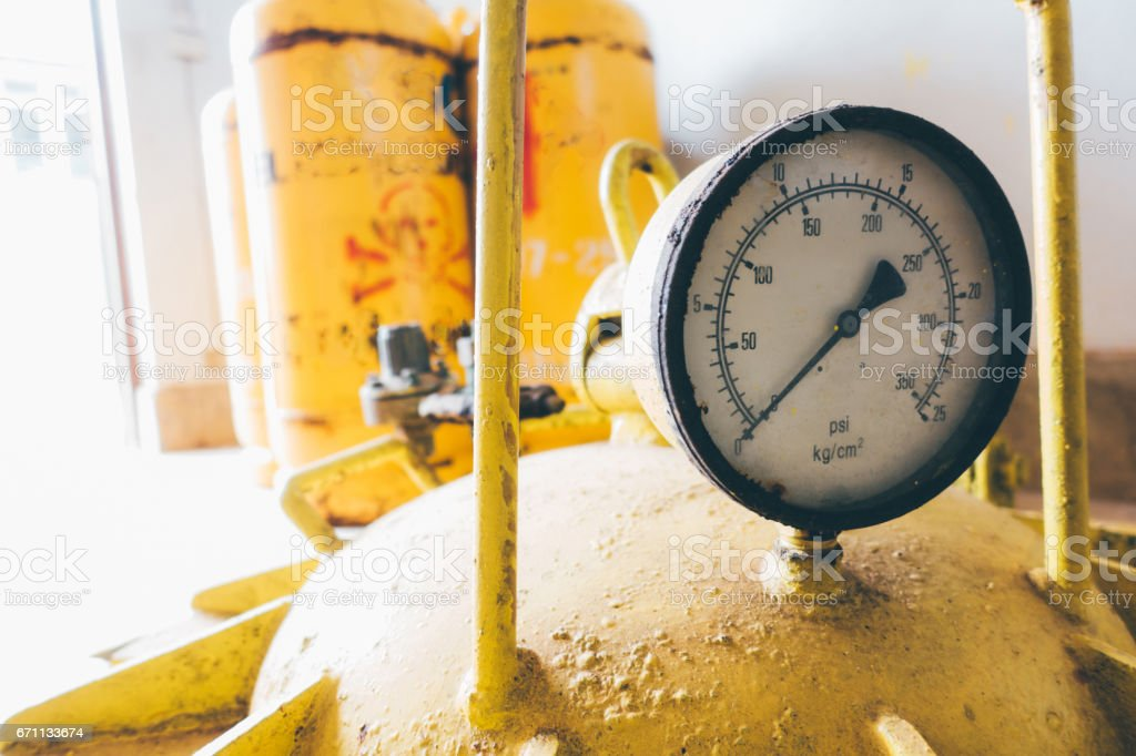 pressure gauges and valves of chlorine gas cylinders stock photo