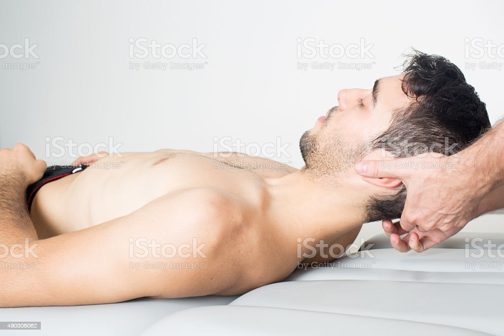 pressure point treatment on head of a man stock photo