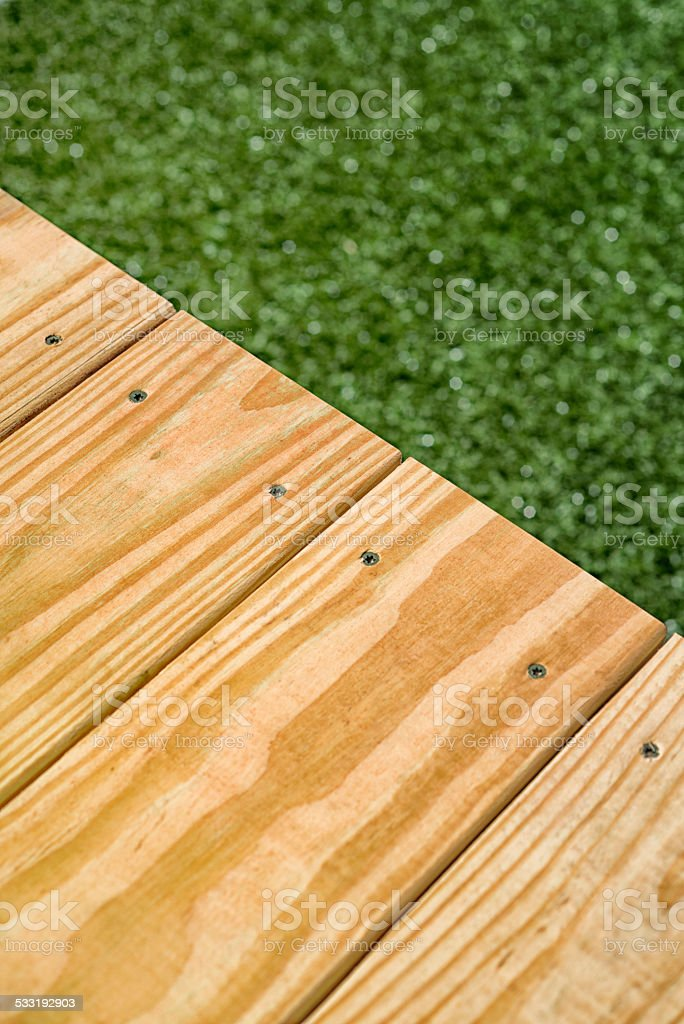 Pressure Treated Wood Deck Edge And Grass Stock Photo