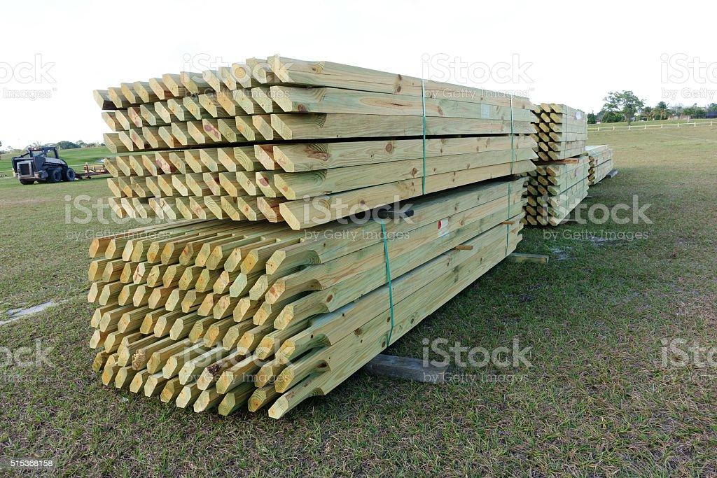 Pressure treated wood fence rails stock photo