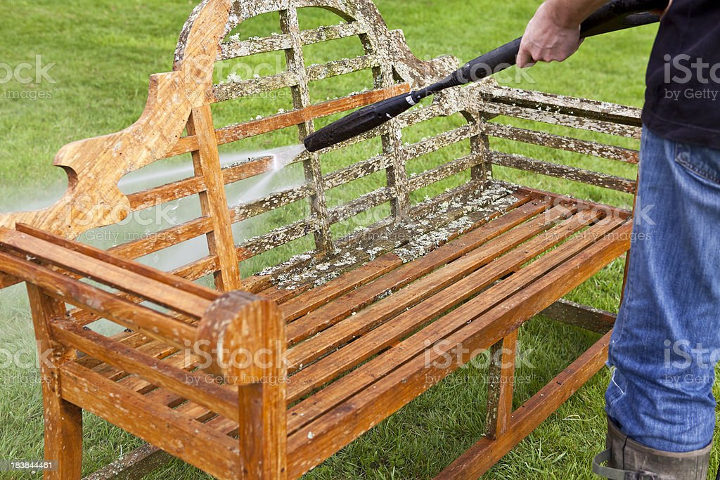 Pressure Washer Cleaning Garden Bench royalty-free stock photo
