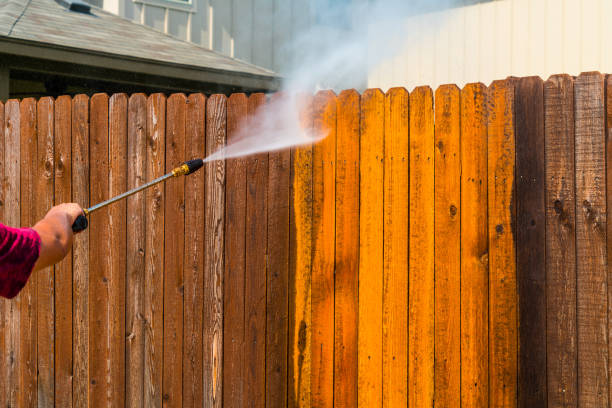 Pressure Washing Wooden Fence stock photo