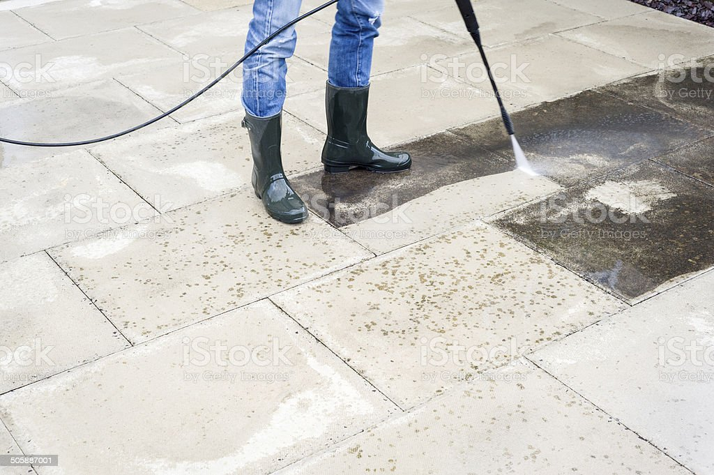 Pressure-washing the patio stock photo