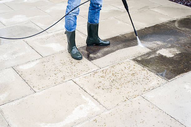 pressure-washing the patio - high pressure cleaning stock photos and pictures