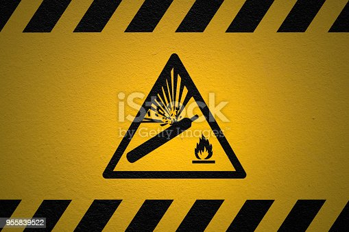 Black striped yellow background with a Pressurized cylinder warning sign and a light effect to dramatize the whole.