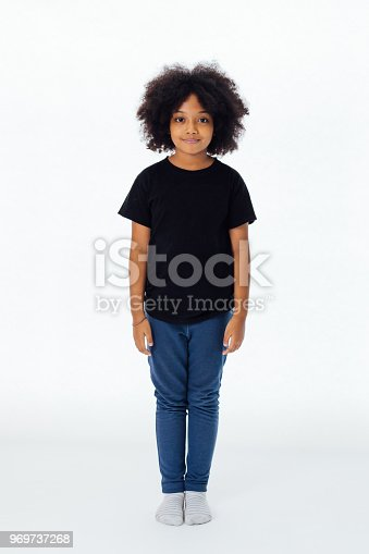 Pre-teen African American kid in casual style standing still isolated in white background