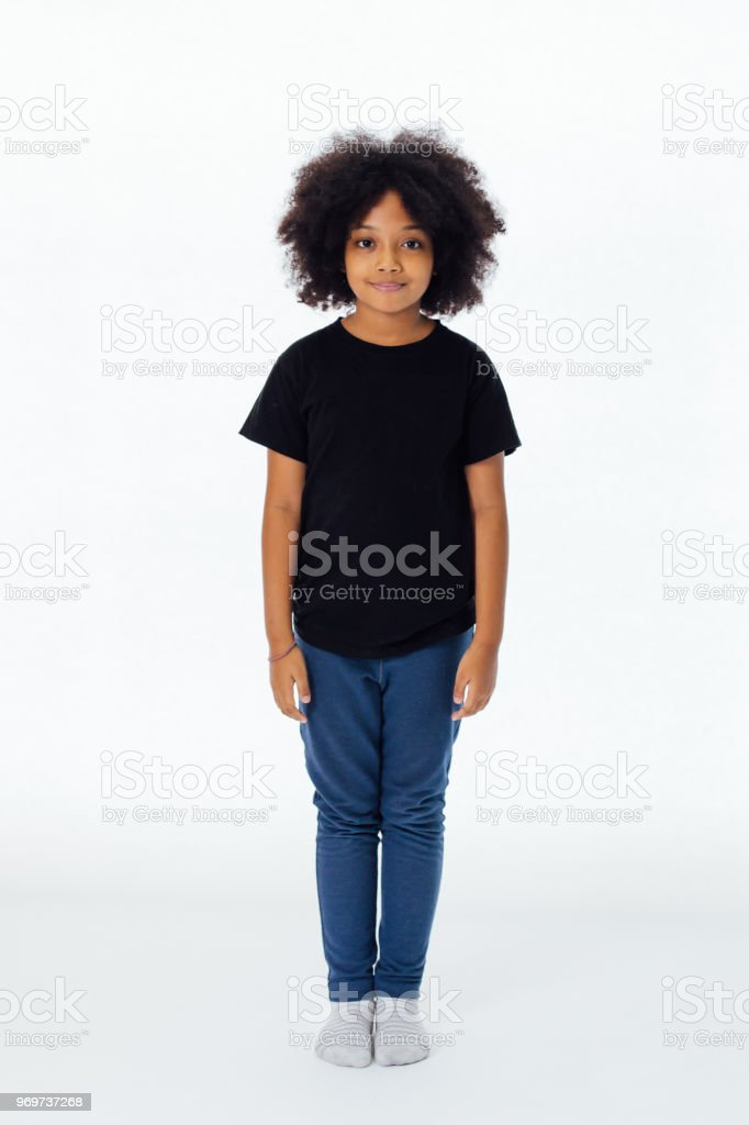 Pre-teen African American kid in casual style standing still isolated in white background stock photo