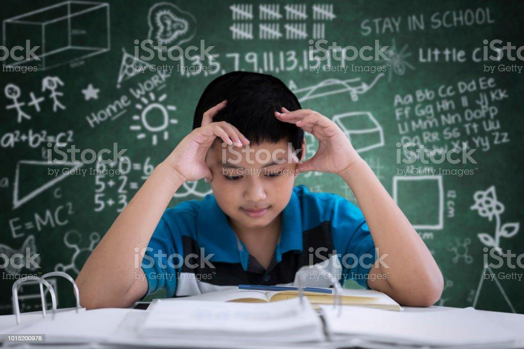 preteen boy student having headache in classroom stock photo more rh istockphoto com