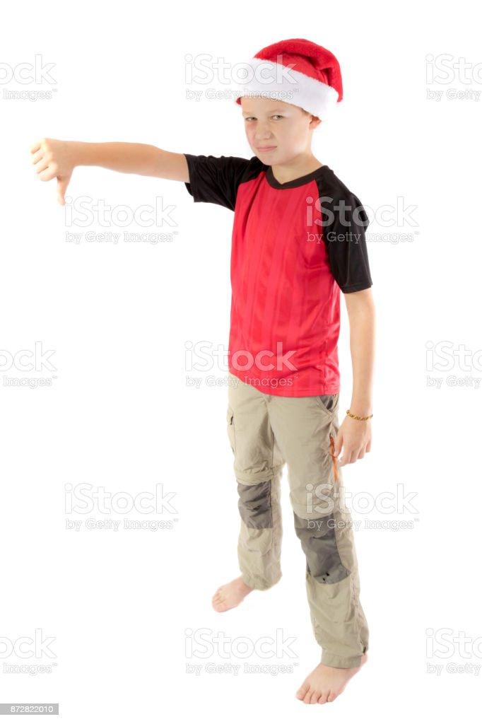 Pre-teen boy wearing a santa hat stock photo