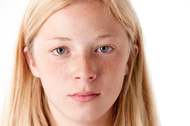 Preteen Caucasion Girl with a Serious Look Closeup Headshot stock photo