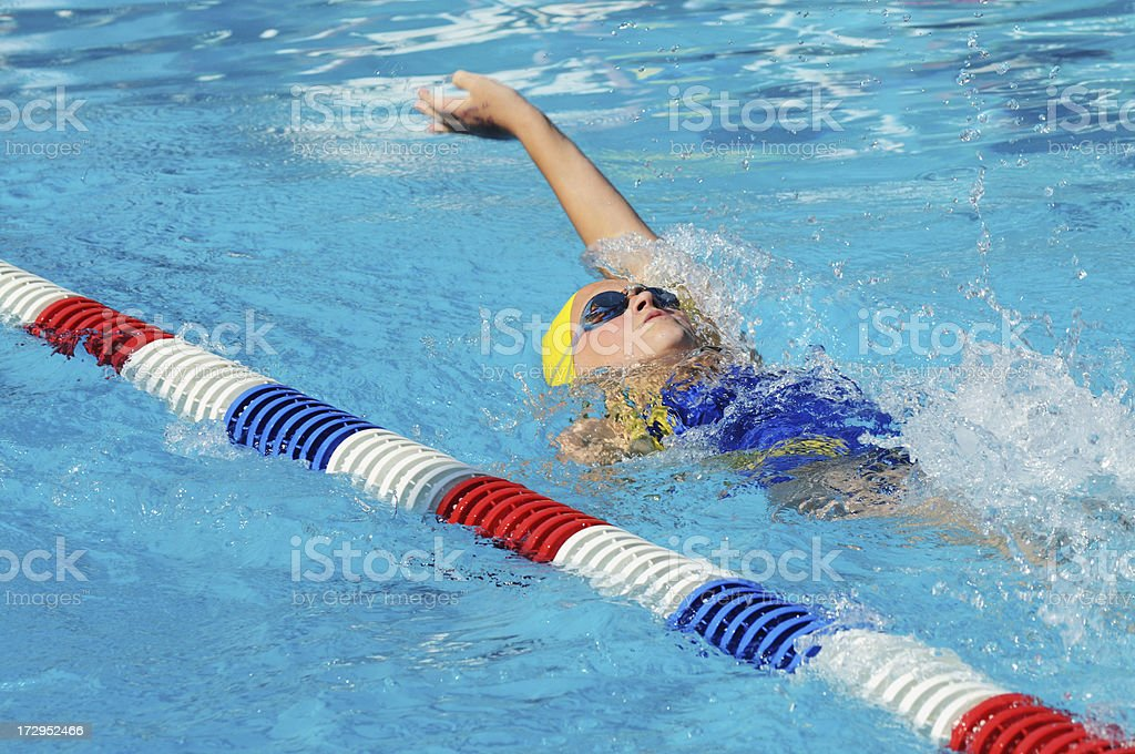 Pre-teen Female Backstroke Swimmer stock photo