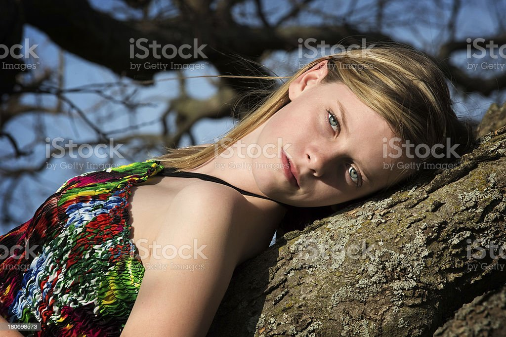 Pre-teen girl against tree royalty-free stock photo