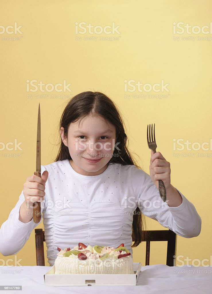Preteen girl and a big cake royalty-free stock photo