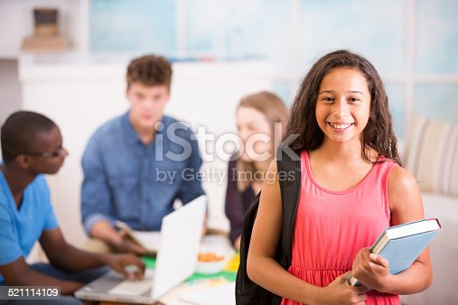 istock Preteen girl backpack, textbook. Teens study together at home. 521114109