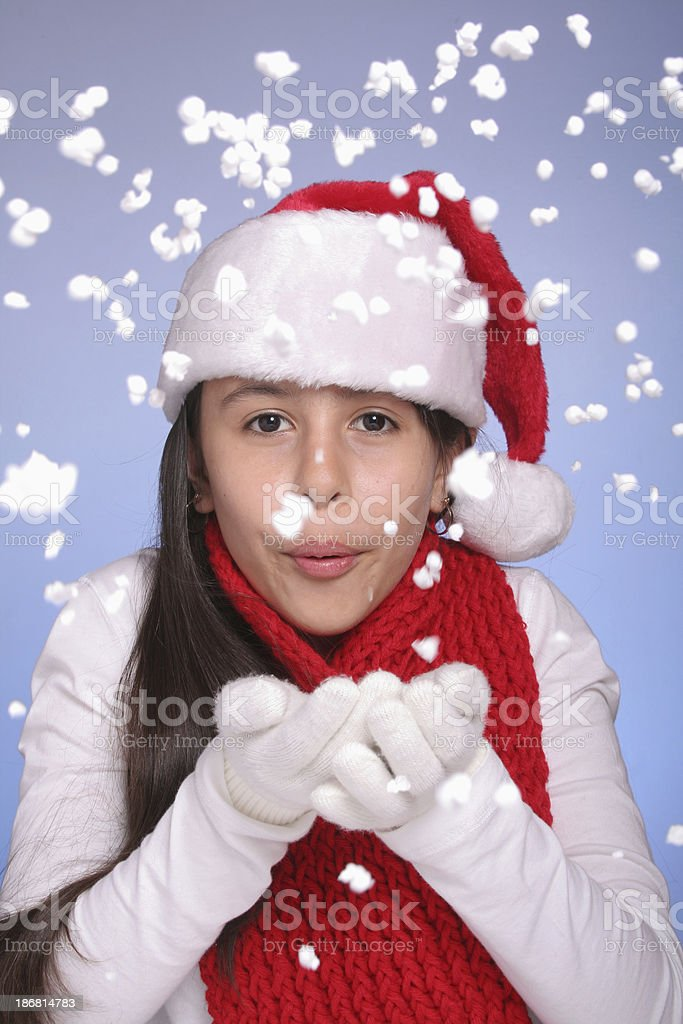 Preteen Girl Blowing Snow royalty-free stock photo