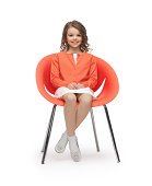 picture of beautiful liitle girl in casual clothes sitting on chair