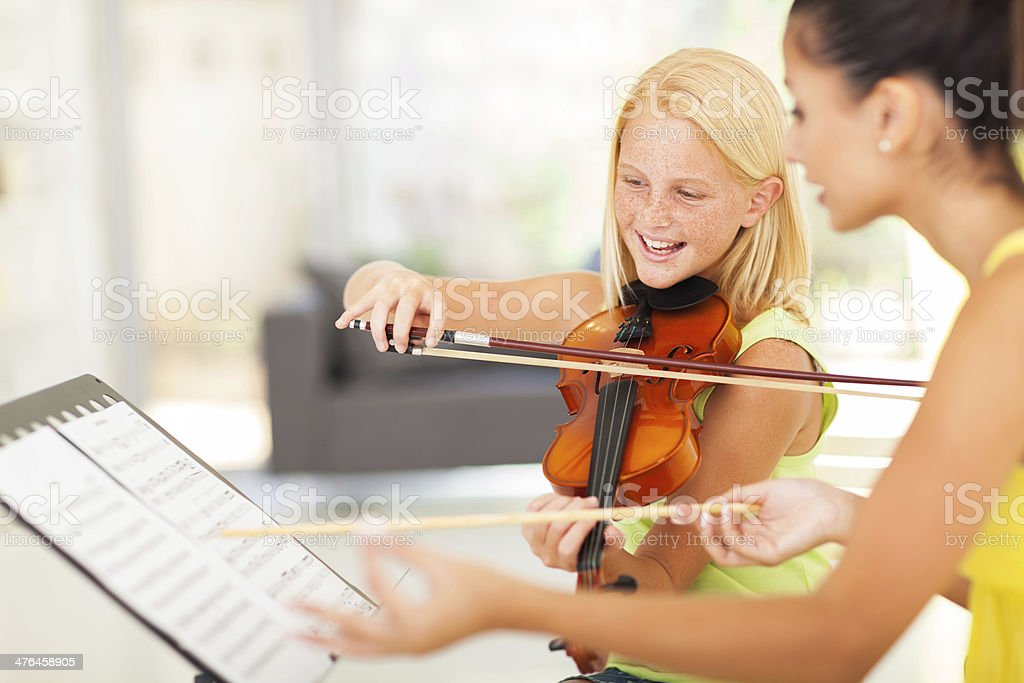preteen girl in music class royalty-free stock photo