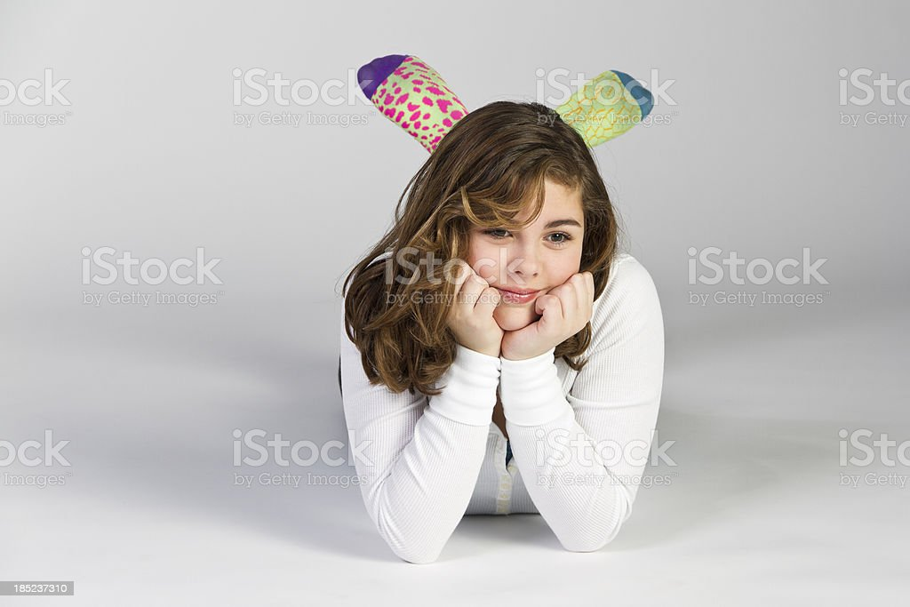 Pre-teen Girl Leaning on Hands stock photo