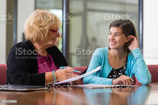 Preteen Girl Meeting With School Counselor Or Therapist Stock Photo - Download Image Now