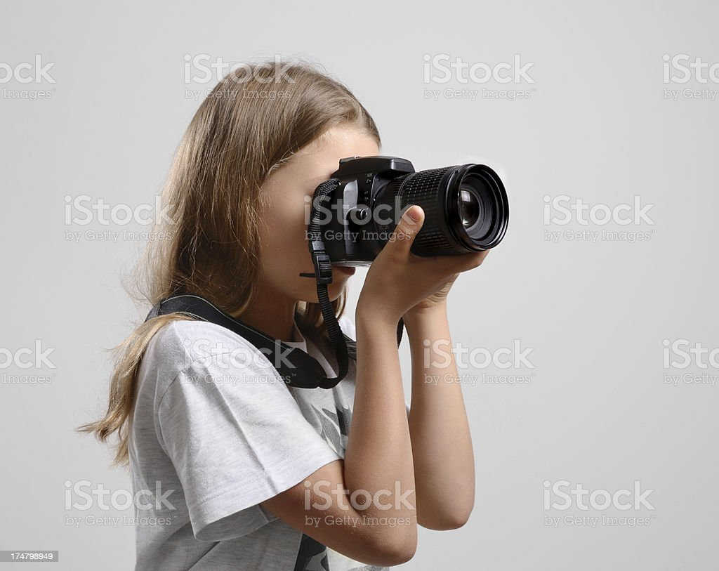 Preteen girl photographing royalty-free stock photo